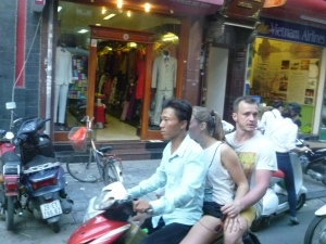 3 Adults.... 1 Bike... You can see the fear in this tourist's eyes